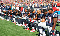 Members of the New England Patriots kneel during the National Anthem before a game against the Houston Texans at Gillette Stadium on September 24, 2017 in Foxboro, Massachusetts. (Photo by Jim Rogash/Getty Images) (Photo: Jim Rogash/Getty Images, 2017 Getty Images)