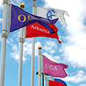 Custom flags with college names for the Arkansas Ports Hall of Fame Museum