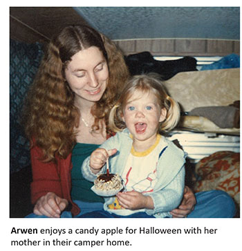 Arwen enjoys a candy apply for Halloween with her mother in their camper home