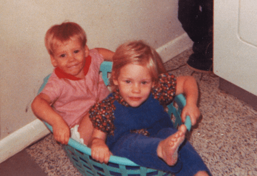 Madison with her brother as children playing