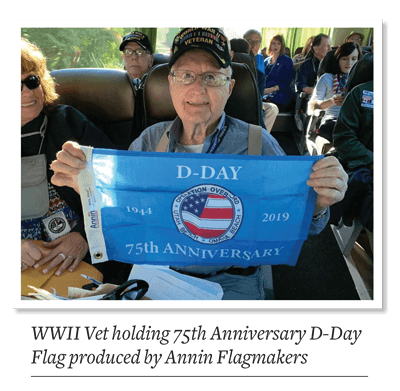 WWII Vet holding 75th Anniversary D-Day Flag produced by Annin Flagmakers