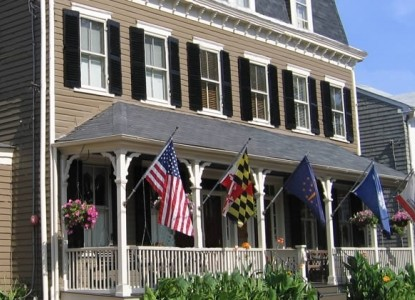 Image result for multiple flags on house