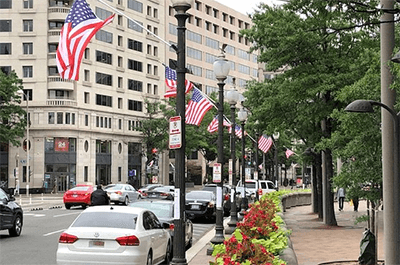 Supporters of statehood for D.C. put up flags with 51 stars. (WTOP/Mitchell Miller)