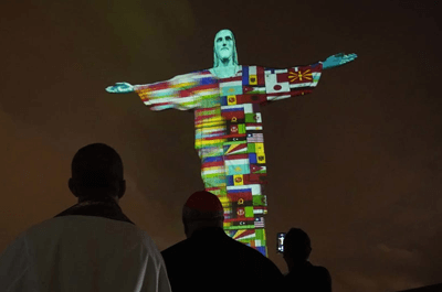 The Christ the Redeemer statue in Brazil was lit up Wednesday during a special mass. Wagner Meier/Getty Images