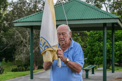 PHOTO: David Floyd beats the sunrise each morning to raise the flag at the local park. (ABC Radio Brisbane: Jessica Hinchliffe)