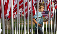 Patrick Keller, 5, of Orange runs through a maze of flags during opening ceremonies for the Field of Valor in Orange on Sunday, November 5, 2017.(Photo by Mindy Schauer, Orange County Register/SCNG)