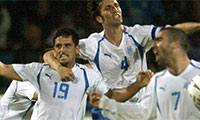 In this Match 26, 2005 file photo, Israel's Abas Suan , left, and Arik Benado , center, celebrate after Suan scored during the World Cup qualifying soccer match against Ireland in Ramat Gan stadium in Tel Aviv, Israel. President Trump's clash with professional football players who knelt during the Star Spangled Banner last weekend in September, 2017 has set off a heated debate over etiquette during the national anthem, but the U.S. is not alone. (AP Photo/Ariel Schalit, File)