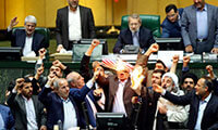 Iranian lawmakers burn two pieces of papers representing the U.S. flag and the nuclear deal/NY MAG