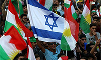 Iraqi Kurds fly an Israeli flag and Kurdish flags during an event to urge people to vote in the upcoming independence referendum in Erbil, the capital of the autonomous Kurdish region of northern Iraq, on September 16, 2017. (AFP/Safin Hamed)