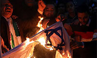 People shout slogans against Israel while burning a makeshift Israeli flag during a protest against Trump's Jerusalem declaration, in front of the Syndicate of Journalists in Cairo, Egypt December 7, 2017. . (photo credit: MOHAMED ABD EL GHANY/REUTERS)