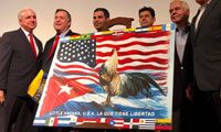The mayor of Miami, Carlos A. Giménez, presents the new flag of Little Havana. @CityofMiami @CityofMiami