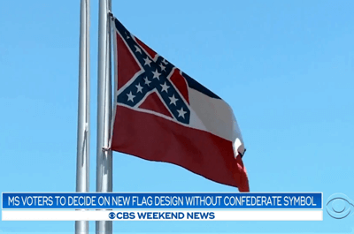 A Mississippi flag flying on a flagpole (CBS News)