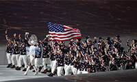 Flag-bearer Todd Lodwick of the U.S. leads his country's contingent during the athletes' parade at the opening ceremony of the Sochi 2014 Winter Olympic Games February 7, 2014.  Credit: Grigory Dukor/Reuters