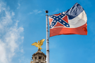 Mississippi state flag flying in front of capitol building in Jackson (Shutterstock)(WHSV)