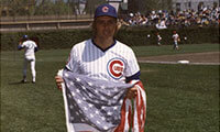 Rick Monday with the flag he saved / Baseball Hall of Fame