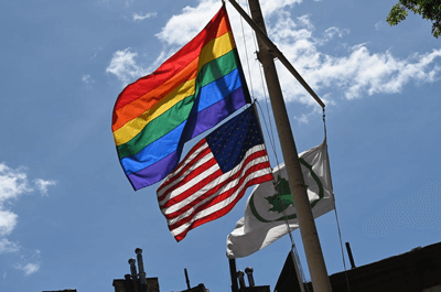 A rainbow flag and an American flag are seen at the Stonewall National Monument, the first LGBTQ national monument, on June 4 in New York City. / Angela Weiss/Getty Images