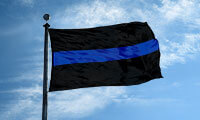 A Thin Blue Line flag flying