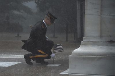 A soldier of the 3d U.S. Infantry Regiment (The Old Guard) stands in front of the Tomb of the Unknown Soldier during a severe storm for Flags In at Arlington National Cemetery, May 23, 2019. Flags In is an annual military operation carried out by The Old Guard before Memorial Day weekend in which soldiers plant over 245,000 U.S. flags at the graves of Arlington National Cemetery. (Maryam Treece/U.S. Army)