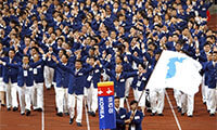 In this Sept. 29, 2002 file photo, athletes from North and South Korea march together, led by a unification flag, during an opening ceremony for the 14th Asian Games in Busan, South Korea. The two sides will do the same at the upcoming Winter Games.  (THE ASSOCIATED PRESS)
