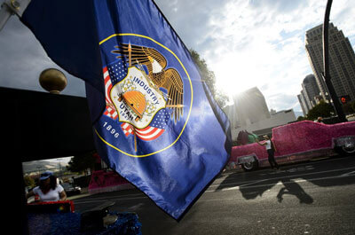 (Steve Griffin | Tribune file photo) In this July 24, 2017, photo, the Utah state flag waves in the morning sun at the start of the Days of '47 Parade in Salt Lake City. A Utah state lawmaker is leading an effort to redesign the flag.