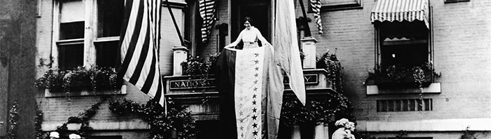 Alice Paul rolls out a victory banner on August 18, 1920 when the 19th Amendment was formally adopted. FlagandBanner.com offers flags and more to keep the Women's Equality Movement going.